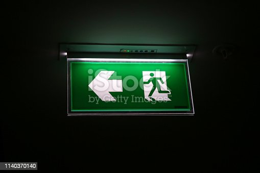 The safety green sign symbol for go to the fire exit.