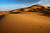 Beautiful simple image of a remote sandy desert landscape of dunes in Liwa desert in Empty Quarter. Abu Dhabi, UAE.
