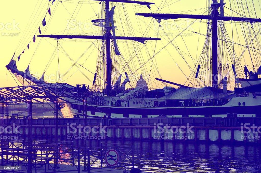 The sailing ship at sunset stock photo
