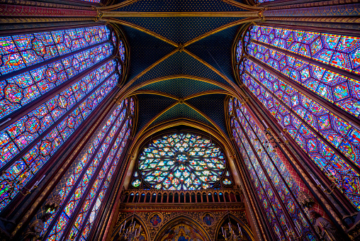 PARIS, FRANCE - MAY 17, 2018:The Sainte-Chapelle wonderful stain-glass windows one of the most visited landmark in Paris, France. Famous stained glass windows and ceiling.