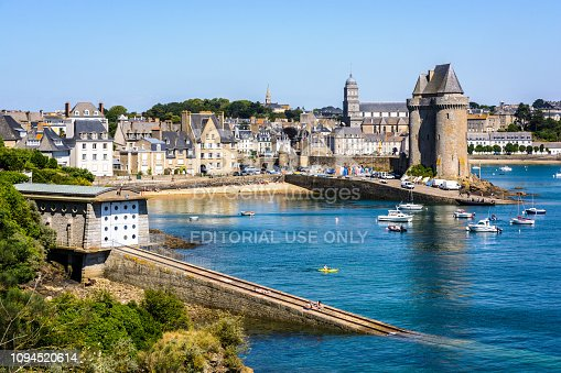 Saint-Malo, France - June 22, 2018: View over the Saint-Pere beach with the Solidor tower which houses the Musee du Long Cours Cap Hornier and the sea lifeguards boat shelter and its launching ramp.