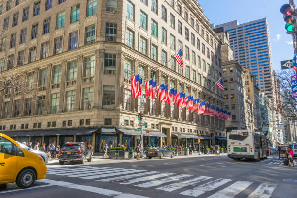 The Saks Fifth Avenue decorated with USA flags in Midtown Manhattan in New York stock photo