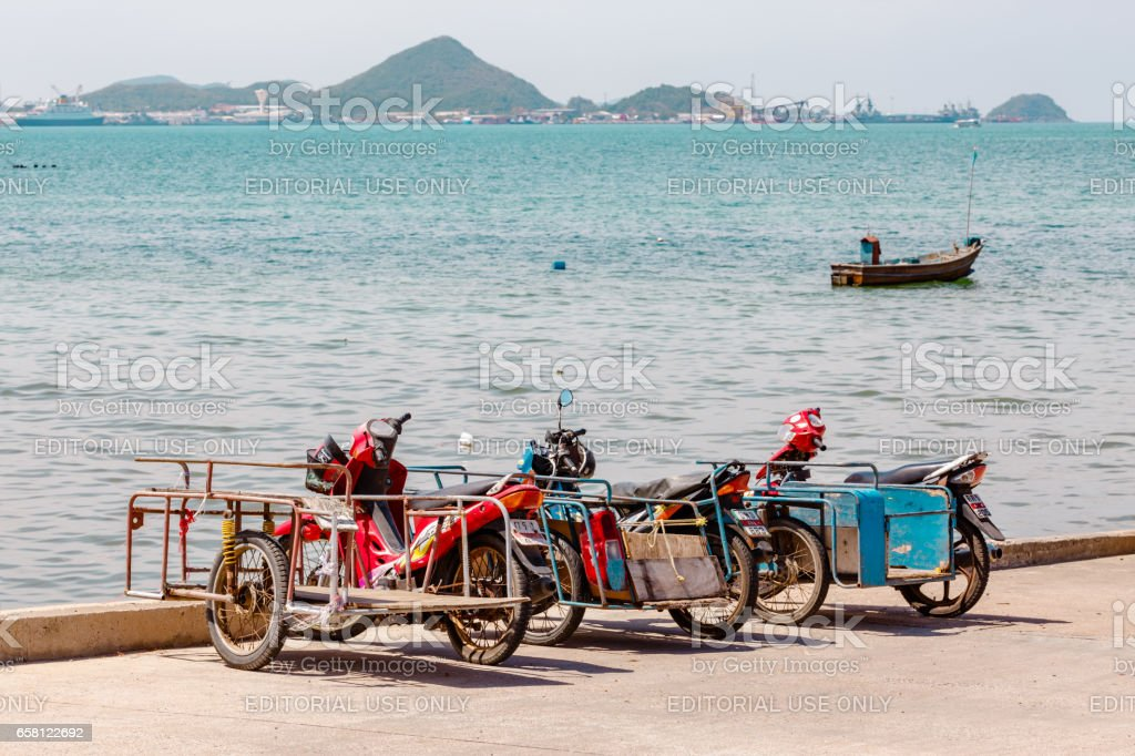 SATTAHIP , THAILAND- MARCH 25, 2017 : The Saleng or motorcycle on the Harbour Bridge. It is Vehicles for fishermen in Sattahip, Thailand. royalty-free stock photo