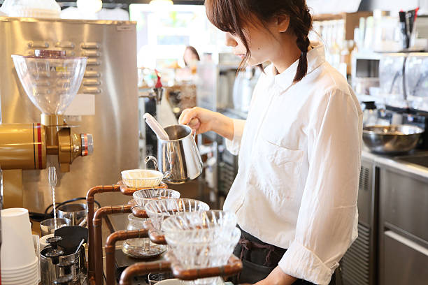 The salesclerk who makes drip coffee stock photo