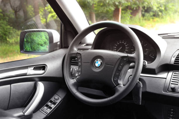 The salon of a BMW car. Black skin. View of the interior of a modern automobile showing the dashboard stock photo