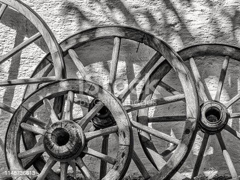 Collection of wagon wheels on display in the Town of St Gilgen in the Salzkammergut area of Austria