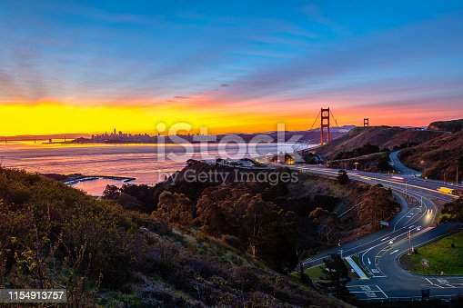 Sunrise begins over the San Francisco Bay Area and the Golden Gate Bridge from the Marin Headlands.