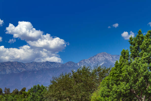 The San Gabriel Mountains viewed from Rancho Cucamonga in the Inland Empire of California The San Gabriel Mountains viewed from Rancho Cucamonga in the Inland Empire of California mount baldy stock pictures, royalty-free photos & images