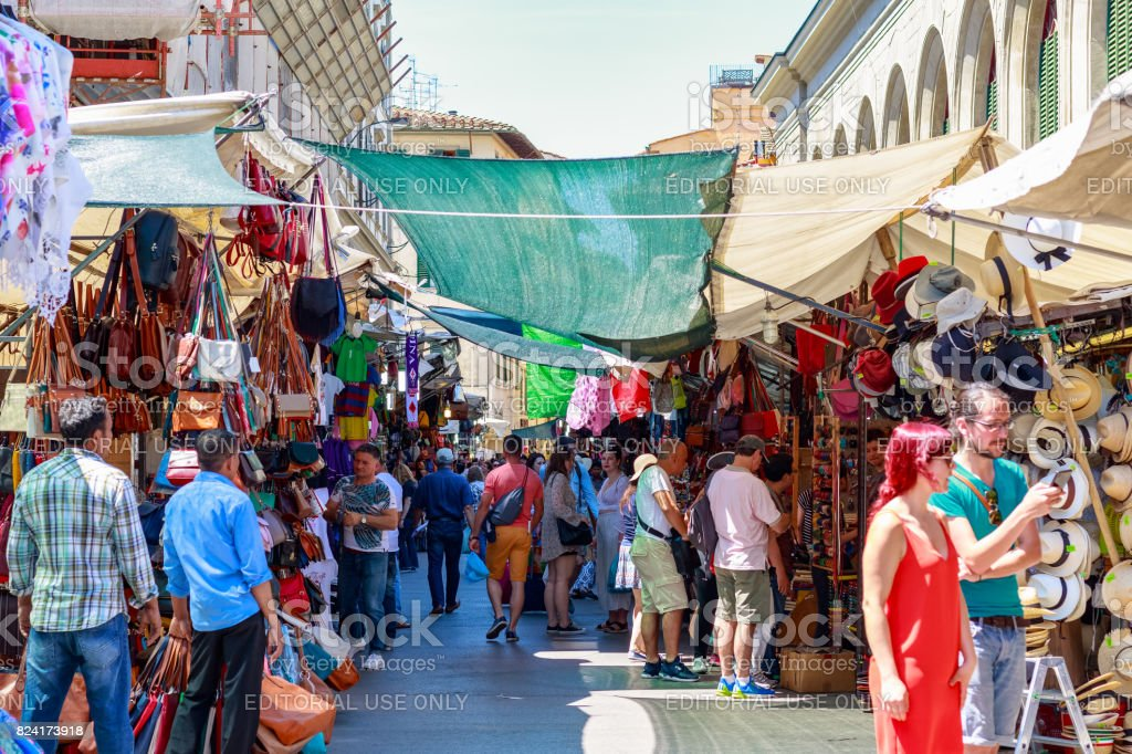 The San Lorenzo market, a popular tourist outdoor market full of stalls selling leather, clothing and souvenirs in Florence stock photo