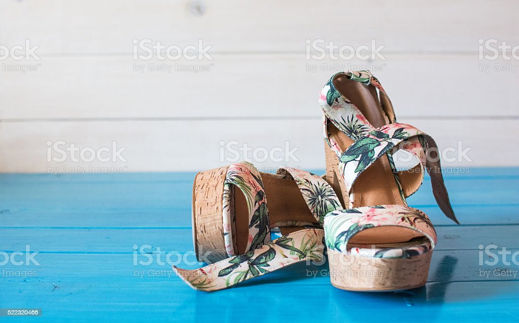 The sandals wiyh tropical print. stock photo