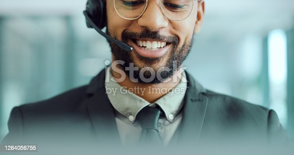Cropped shot of a young man using a headset in a modern office