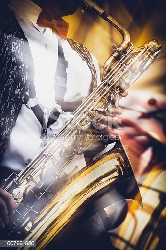istock The saxophonist expressively plays the gold saxophone 1007661680