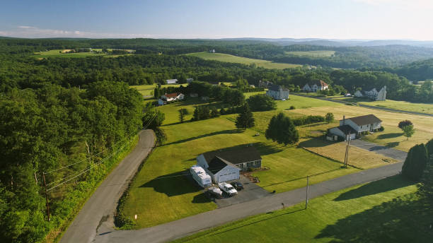 the scenery aerial view of poconos, monroe county, pennsylvania. the sunny summer morning. the panoramic overview over the field and forest to the kunkletown, then to the small farm near by the road. - rural scene stock pictures, royalty-free photos & images