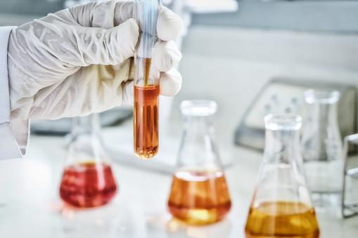 istock The scientist test the natural product extract, oil and biofuel solution, in the chemistry laboratory. sepia or retro tone 1053754390