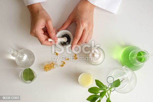 istock the scientist,dermatologist testing the organic natural product in the laboratory.research and development beauty skincare concept.blank package,bottle,container .cream,serum.hand 902812052
