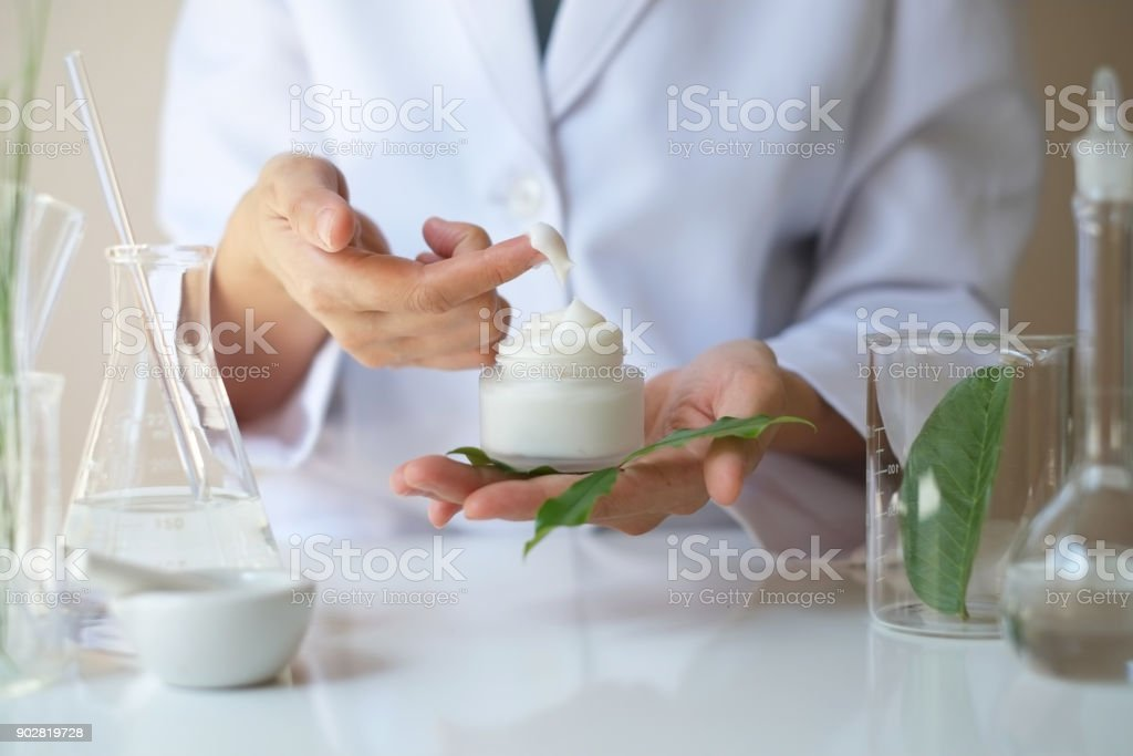the scientist,dermatologist testing the organic natural product in the laboratory.research and development beauty skincare concept.blank package,bottle,container .cream,serum. stock photo