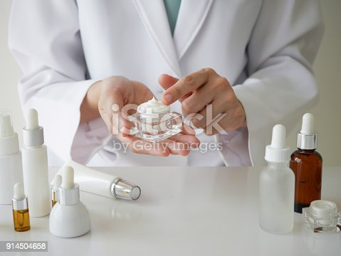 istock the scientist,dermatologist testing the organic natural product in the laboratory.research and development beauty skincare concept.blank package,bottle,container .cream,serum.hand 914504658