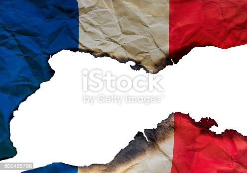 800485914istockphoto The Scorched French flag on white background, concept picture about terrorism in the world and in France 800485796