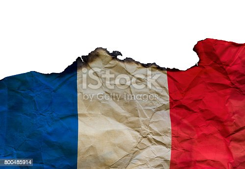 800485914istockphoto The Scorched French flag on white background, concept picture about terrorism in the world and in France 800485914