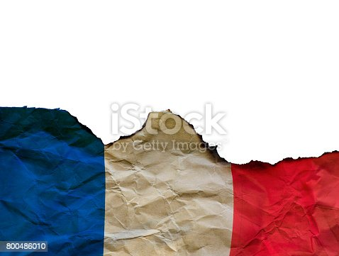 800485914istockphoto The Scorched French flag on white background, concept picture about terrorism in the world and in France 800486010