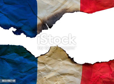 800485914istockphoto The Scorched French flag on white background, concept picture about terrorism in the world and in France 800486148