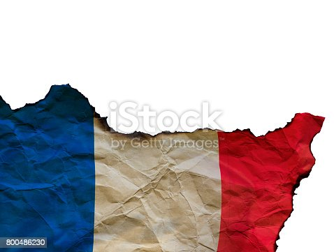 800485914istockphoto The Scorched French flag on white background, concept picture about terrorism in the world and in France 800486230