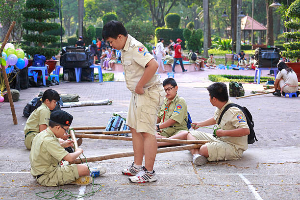 the scouts set ropes with bamboo stock photo