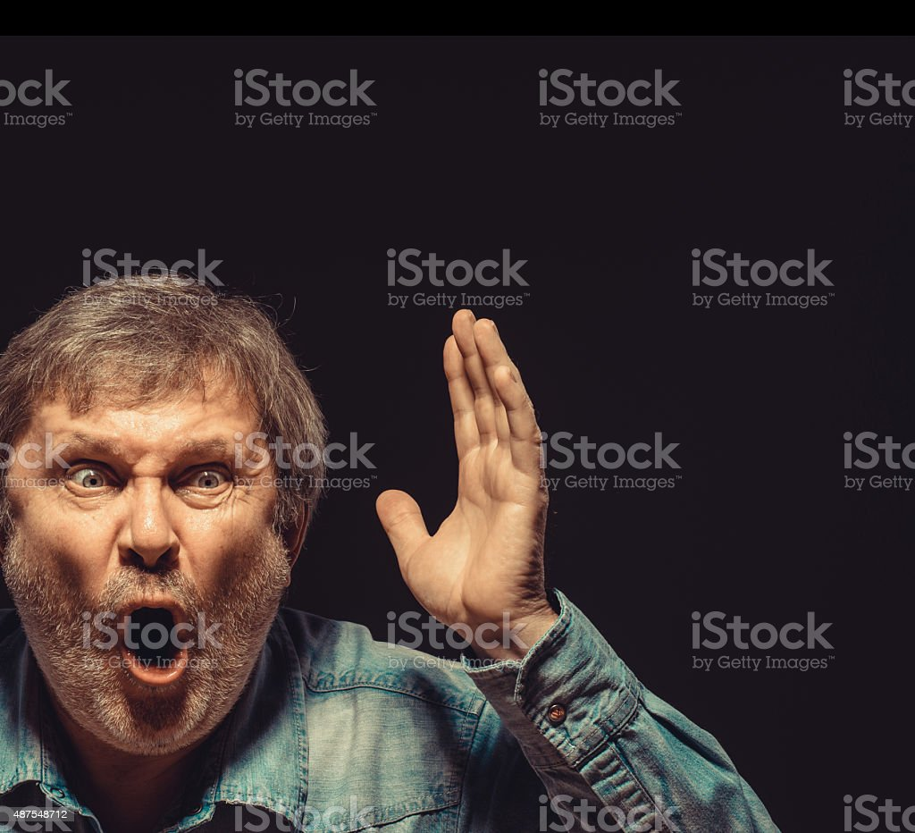 The screaming man in denim shirt stock photo