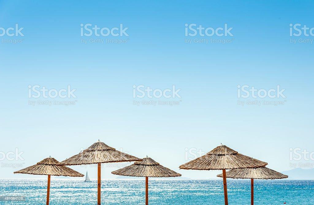 The sea and parasols at the Beach stock photo