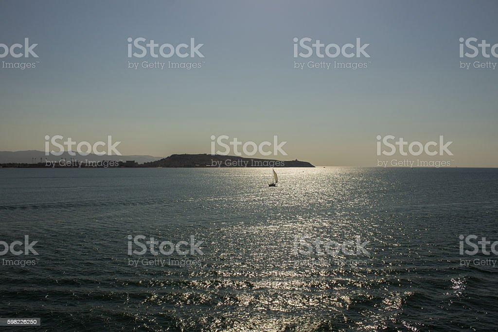 the sea at dawn greets a small boat foto royalty-free