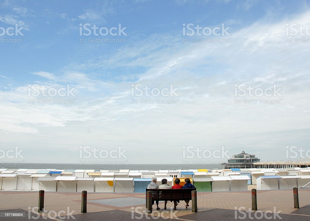 the sea beach-huts and a pier royalty-free stock photo