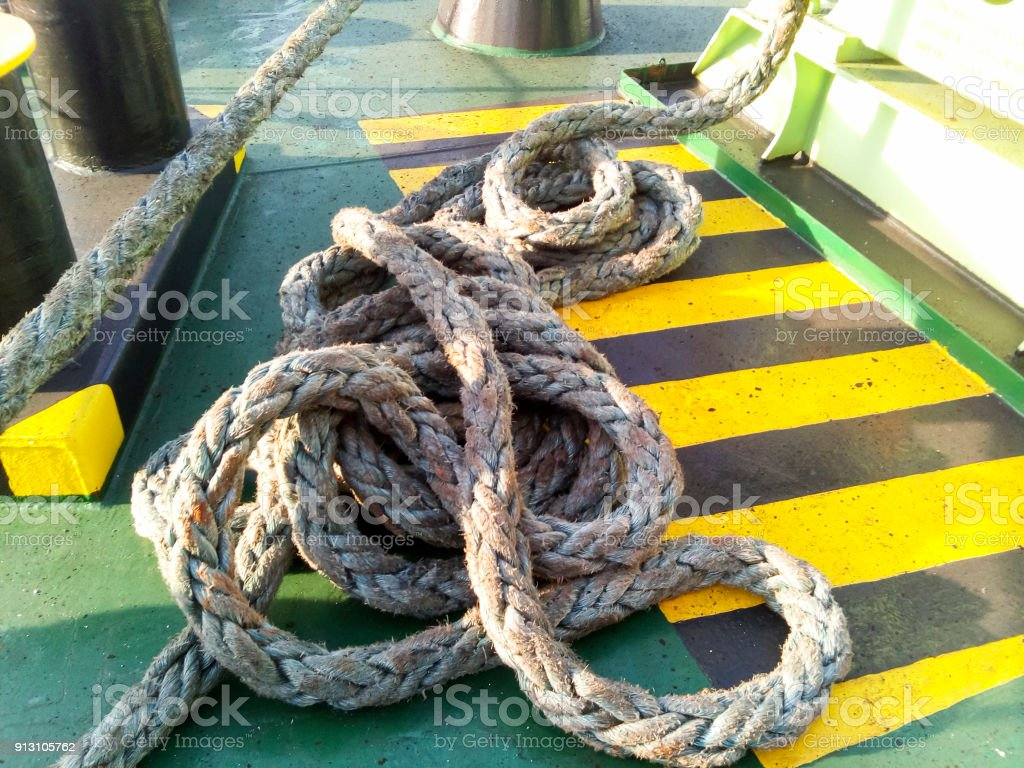 The sea rope on the deck of the ship stock photo