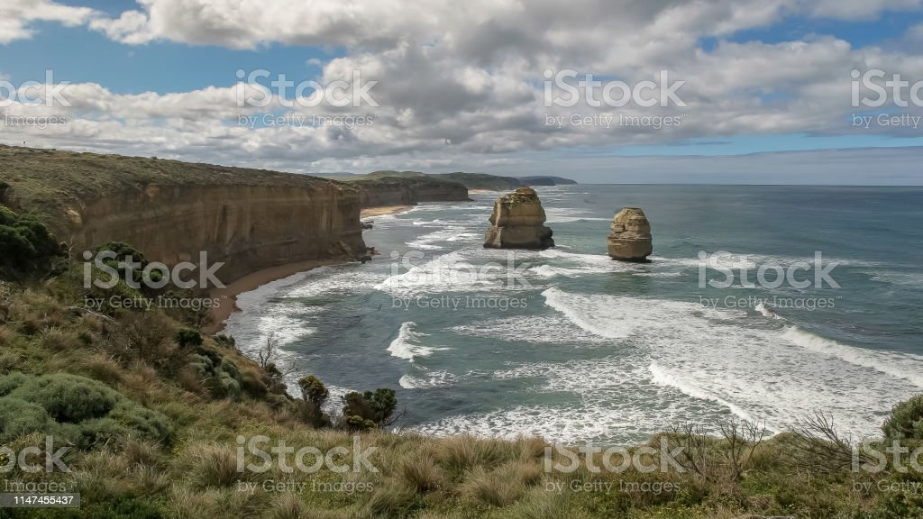 the sea stacks known as gog and magog on the great ocean road in...