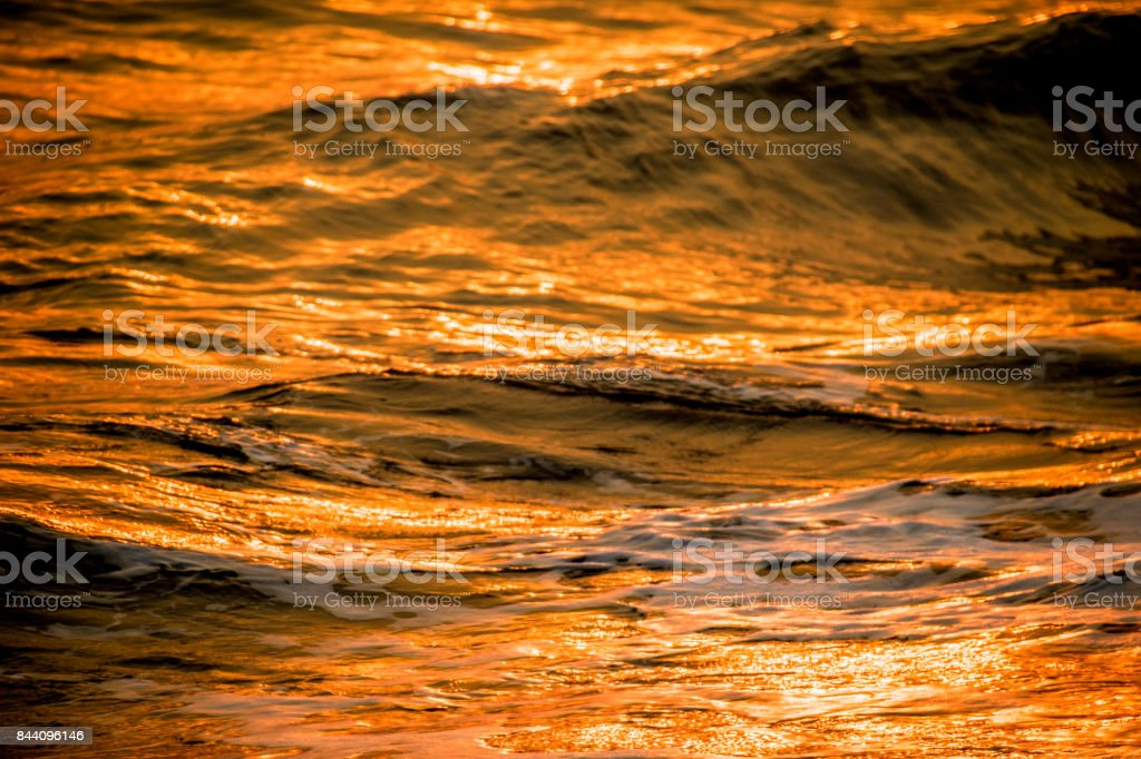 The sea surface, golden water, at Sauce Grande beach, Argentina, South America stock photo
