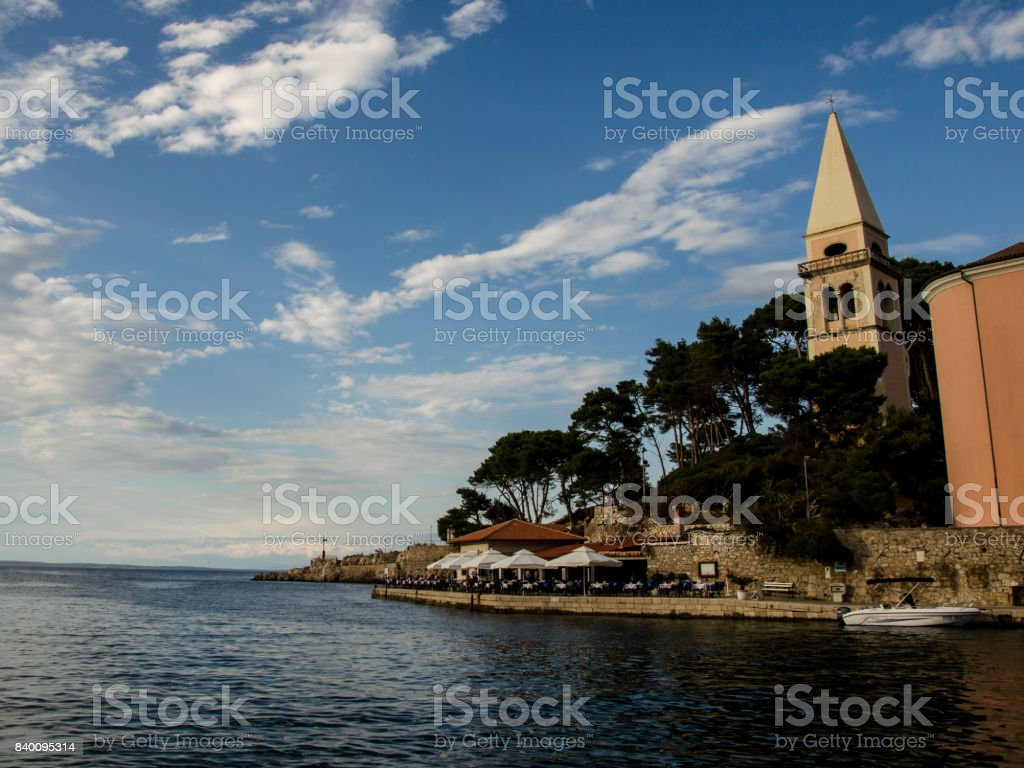 the sea , the clouds and the bell tower stock photo