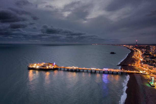 The seafront palace pier in brighton illuminated at night aerial view picture id1192745754?b=1&k=6&m=1192745754&s=612x612&w=0&h=ojyiajqv0ndiabknlwm  gxlna1f4l oxtebysfnch8=
