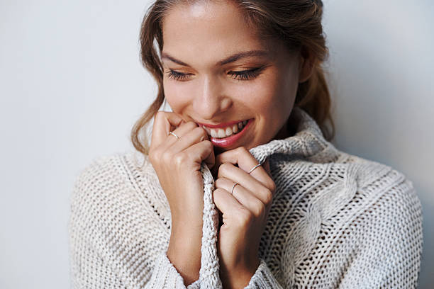 The season for snuggly sweaters Cropped shot of beautiful young woman wearing a sweater indoorshttp://195.154.178.81/DATA/i_collage/pu/shoots/805301.jpg sweater stock pictures, royalty-free photos & images