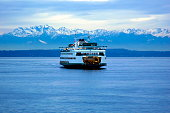 The Seattle-Bremerton ferry at dusk and set against the Olympic Mountains at dusk on December 30, 2006.