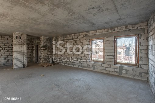 466705128istockphoto The second attic floor of the house. overhaul and reconstruction. Working process of warming inside part of roof. House or apartment is under construction, remodeling, renovation, restoration. 1076196544