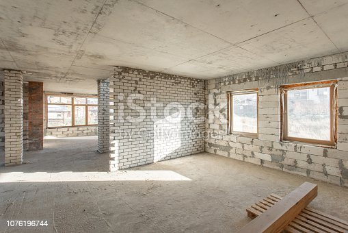 466705128istockphoto The second attic floor of the house. overhaul and reconstruction. Working process of warming inside part of roof. House or apartment is under construction, remodeling, renovation, restoration. 1076196744