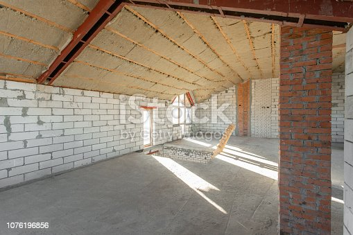 466705128istockphoto The second attic floor of the house. overhaul and reconstruction. Working process of warming inside part of roof. House or apartment is under construction, remodeling, renovation, restoration. 1076196856
