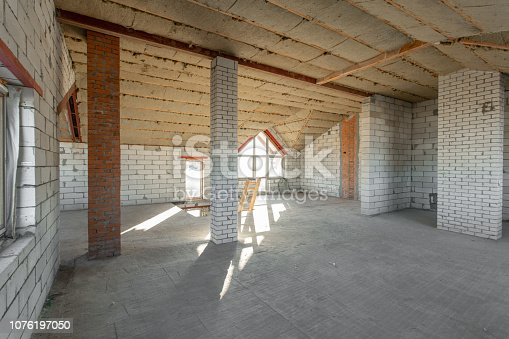 466705128istockphoto The second attic floor of the house. overhaul and reconstruction. Working process of warming inside part of roof. House or apartment is under construction, remodeling, renovation, restoration. 1076197050