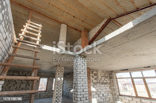 466705128istockphoto The second attic floor of the house. overhaul and reconstruction. Working process of warming inside part of roof. House or apartment is under construction, remodeling, renovation, restoration. 1076198766