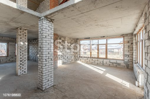 466705128istockphoto The second attic floor of the house. overhaul and reconstruction. Working process of warming inside part of roof. House or apartment is under construction, remodeling, renovation, restoration. 1076198800