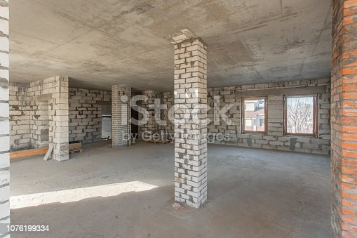 466705128istockphoto The second attic floor of the house. overhaul and reconstruction. Working process of warming inside part of roof. House or apartment is under construction, remodeling, renovation, restoration. 1076199334