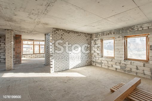 466705128 istock photo The second attic floor of the house. overhaul and reconstruction. Working process of warming inside part of roof. House or apartment is under construction, remodeling, renovation, restoration. 1076199500