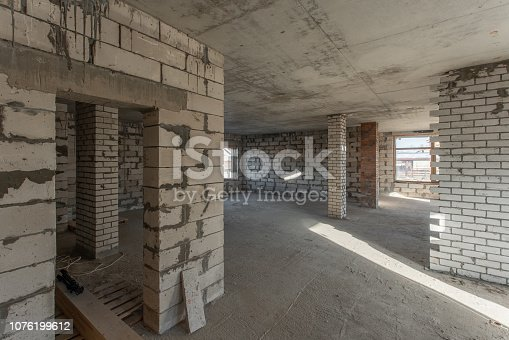 466705128istockphoto The second attic floor of the house. overhaul and reconstruction. Working process of warming inside part of roof. House or apartment is under construction, remodeling, renovation, restoration. 1076199612