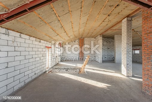 466705128istockphoto The second attic floor of the house. overhaul and reconstruction. Working process of warming inside part of roof. House or apartment is under construction, remodeling, renovation, restoration. 1076200006