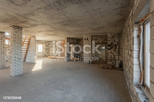 466705128istockphoto The second attic floor of the house. overhaul and reconstruction. Working process of warming inside part of roof. House or apartment is under construction, remodeling, renovation, restoration. 1076200348