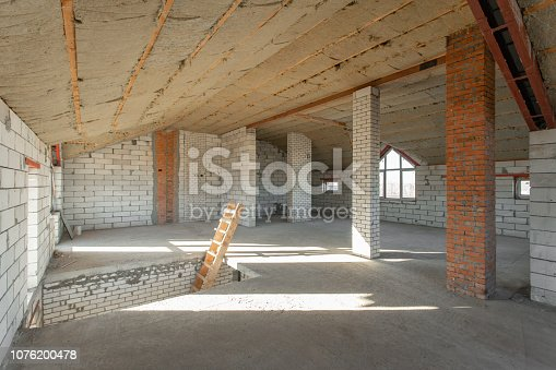 466705128 istock photo The second attic floor of the house. overhaul and reconstruction. Working process of warming inside part of roof. House or apartment is under construction, remodeling, renovation, restoration. 1076200478